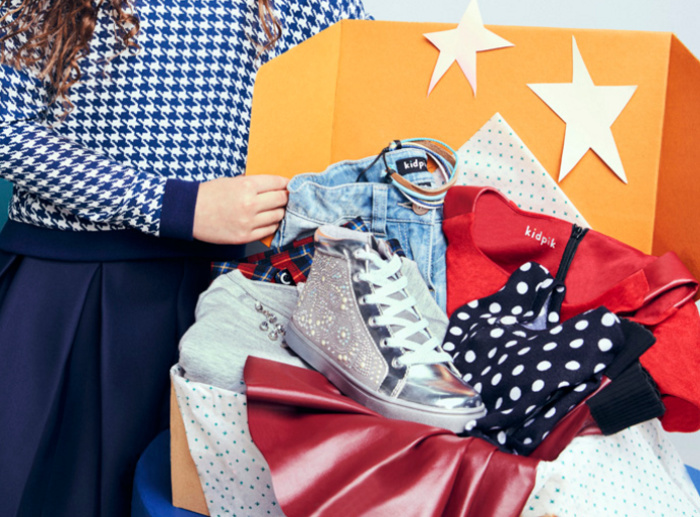 Girl opens a KidPik subscription box with sparkly high tops and other clothing items