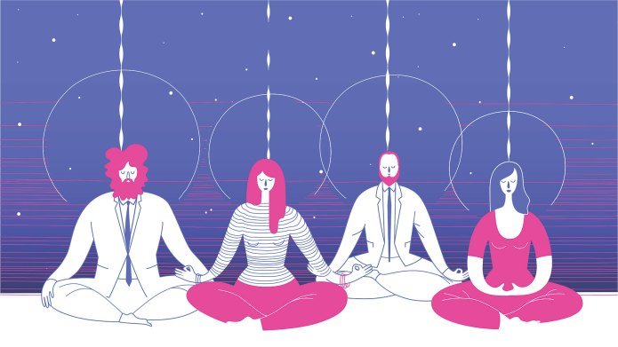 People sitting down meditating in office