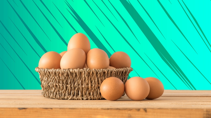 Egg in a basket on wooden