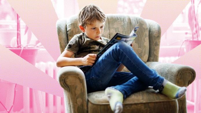 Boy reading magazine