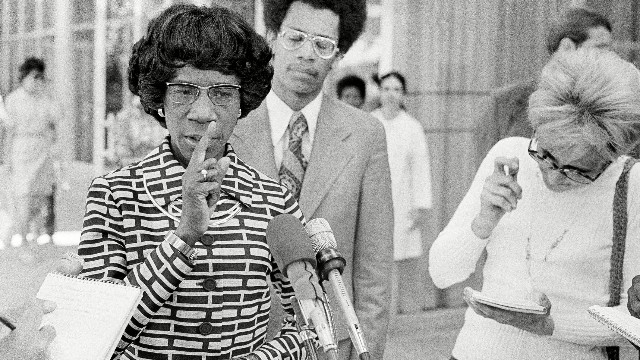 Shirley Chisholm talks with newsmen after visiting Alabama Governor George Wallace