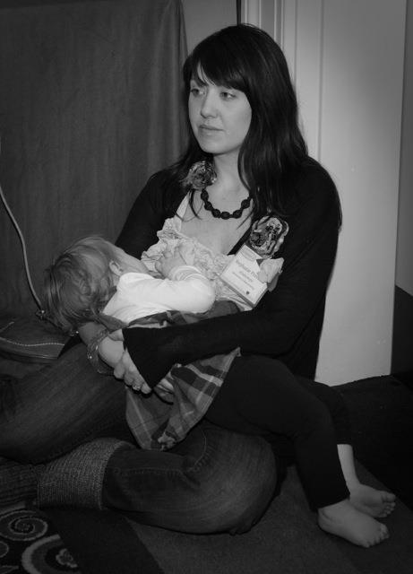 black and white photo of breastfeeding mom