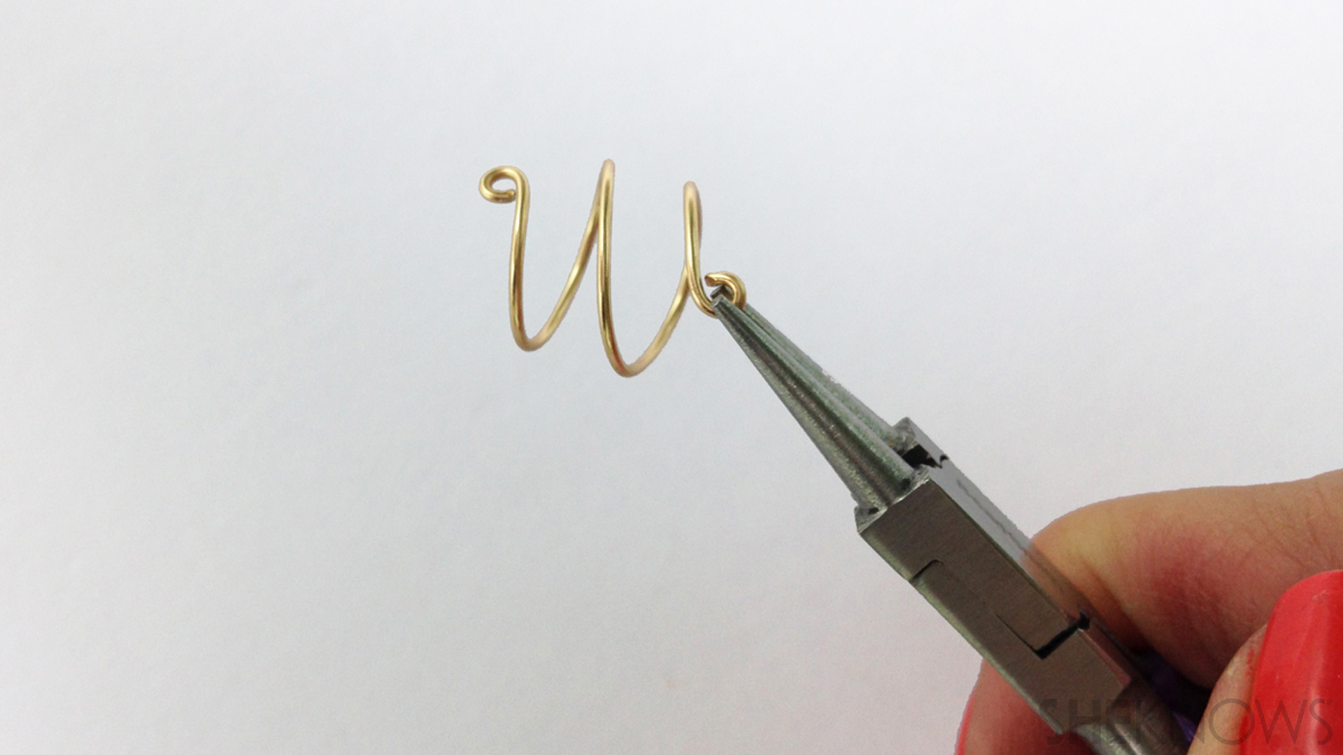 Using pliers, curl the ends into loops