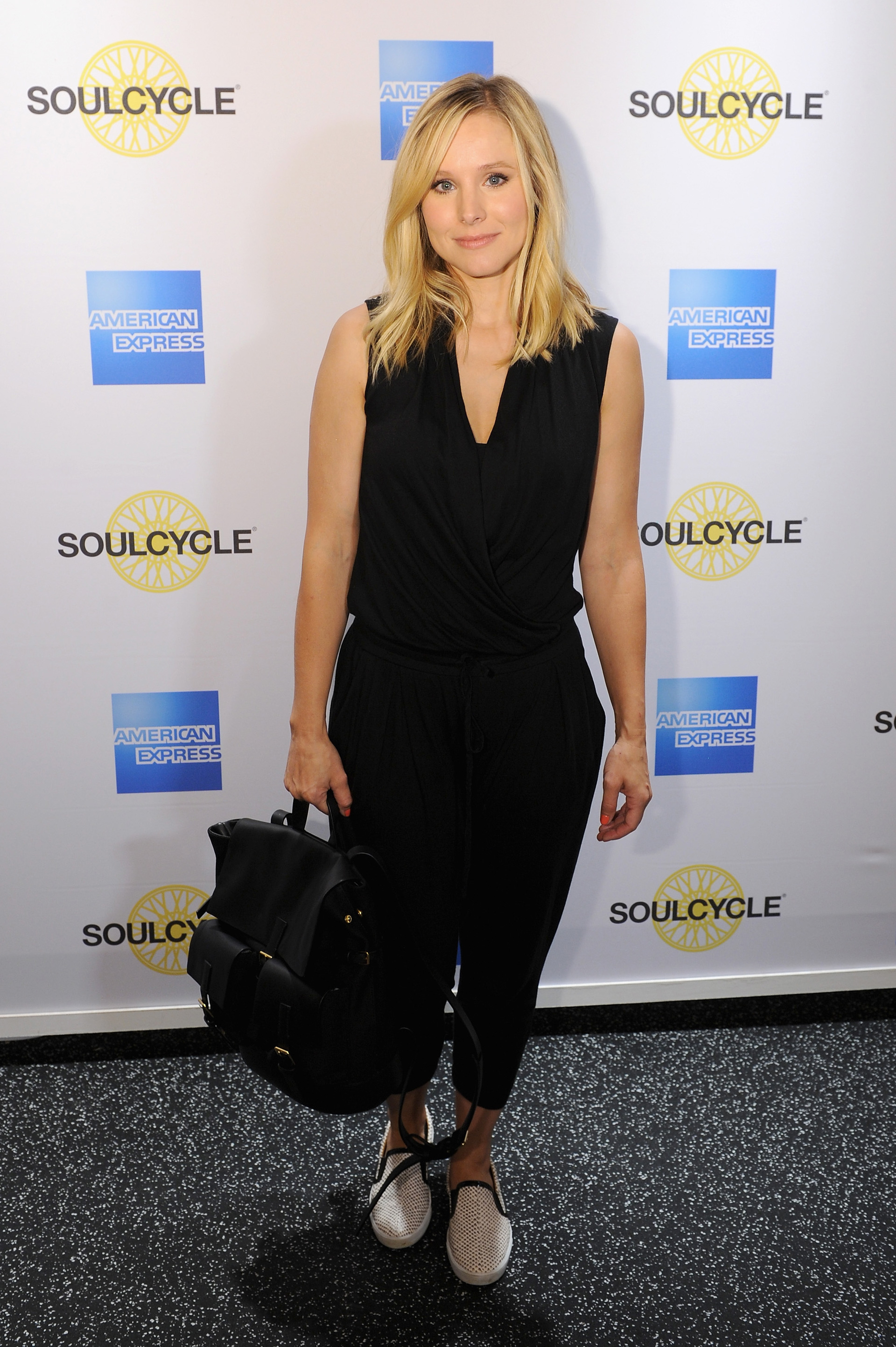 Funny lady Kristen Bell toted her black backpack on the red carpet with her for a recent press appearance.