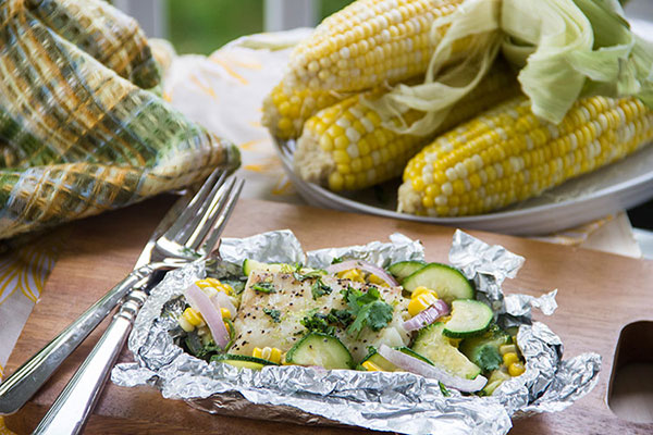 Grilled fish in foil packet