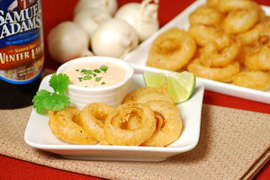 Mini buffalo onion rings with spicy cilantro dipping sauce