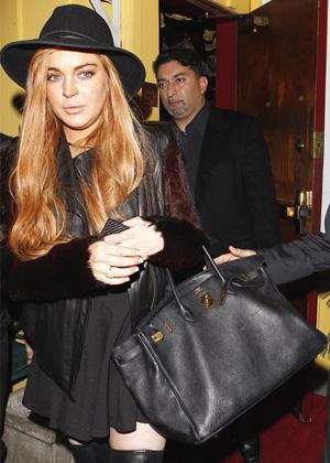 A handbag that says you don't really need the job