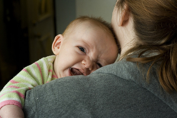 Baby photo fails - Unhappy cuddler