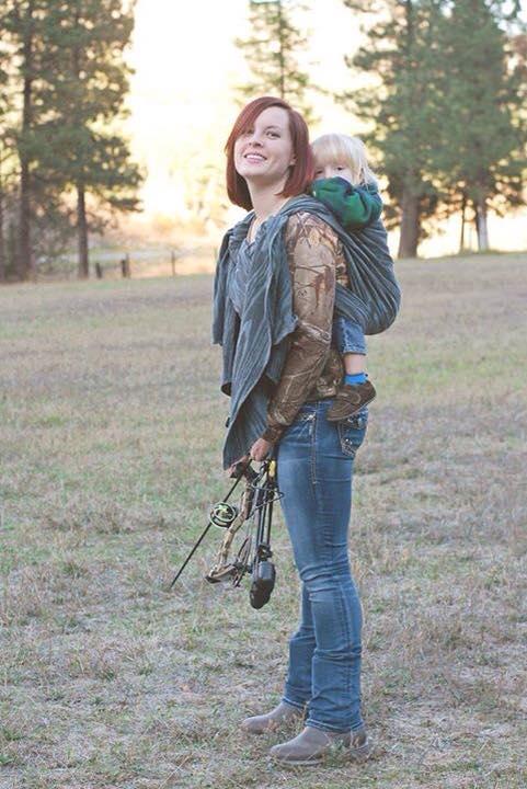 Tara babywearing with a bow