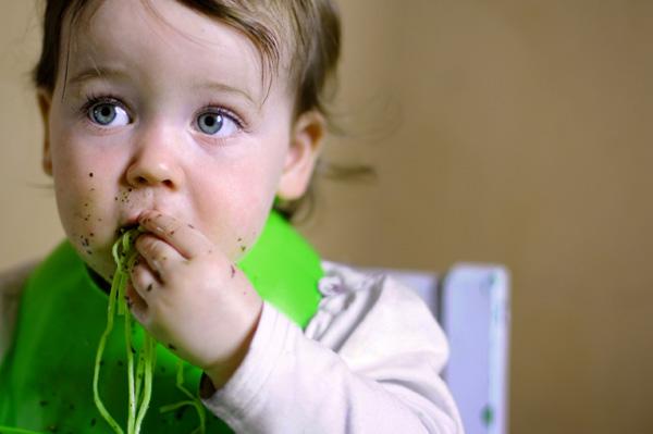 baby eating pasta