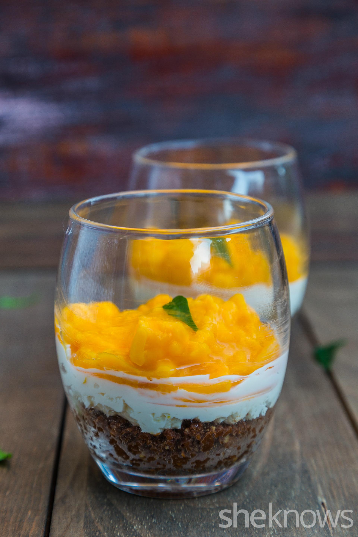 Mini mango cheesecake with chocolate crust in jars