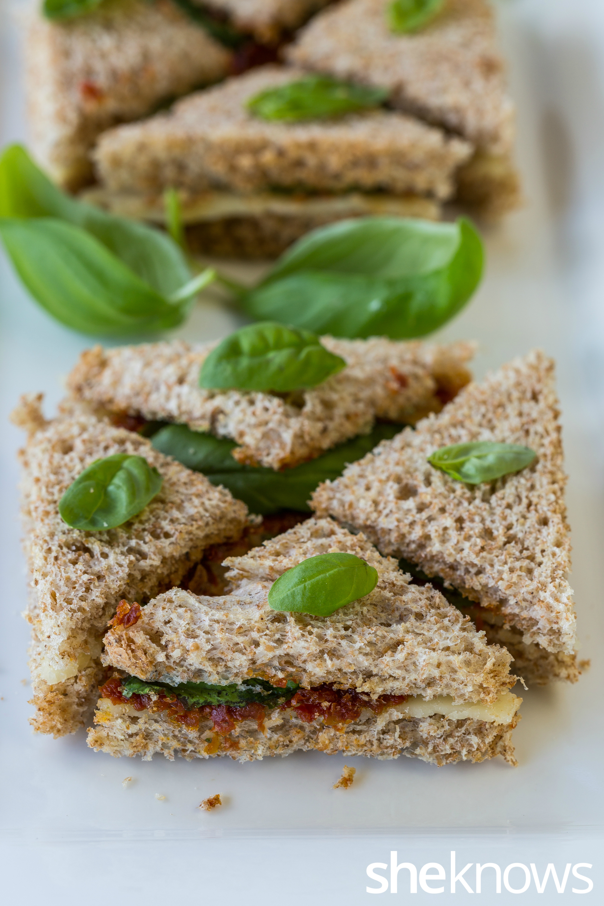 Sun-dried tomato paste, cheese & basil tea sandwich