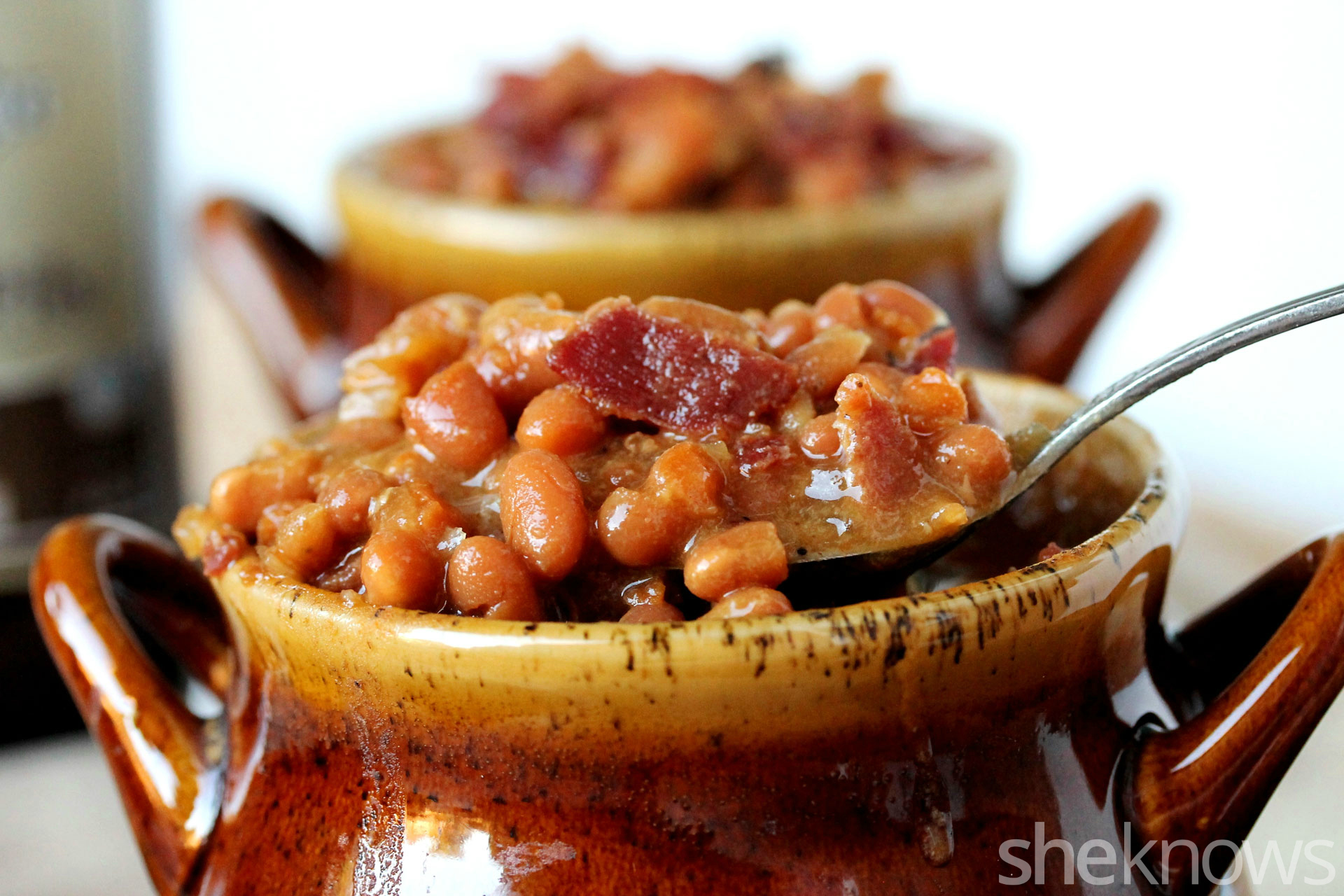 slow cooker baked beans in spoon