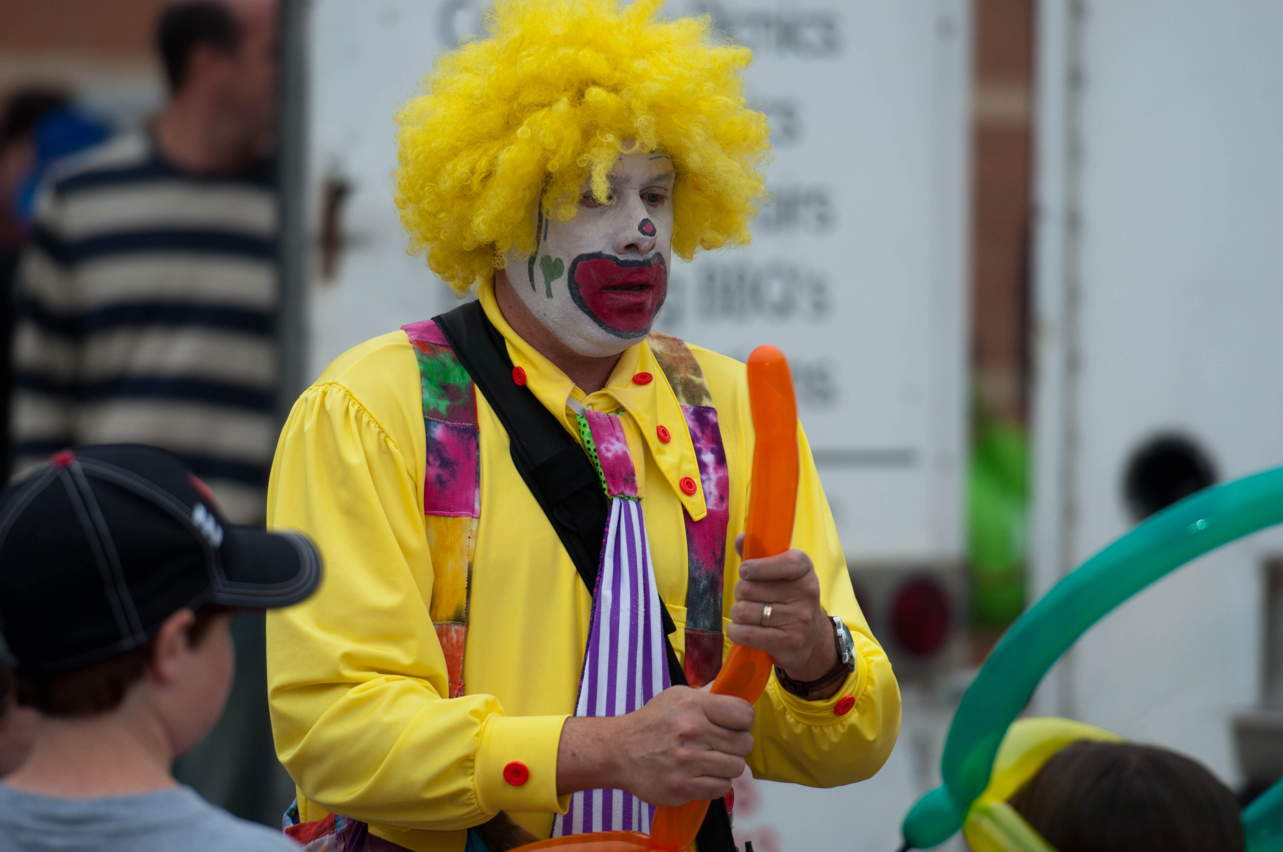 clown making balloon animals