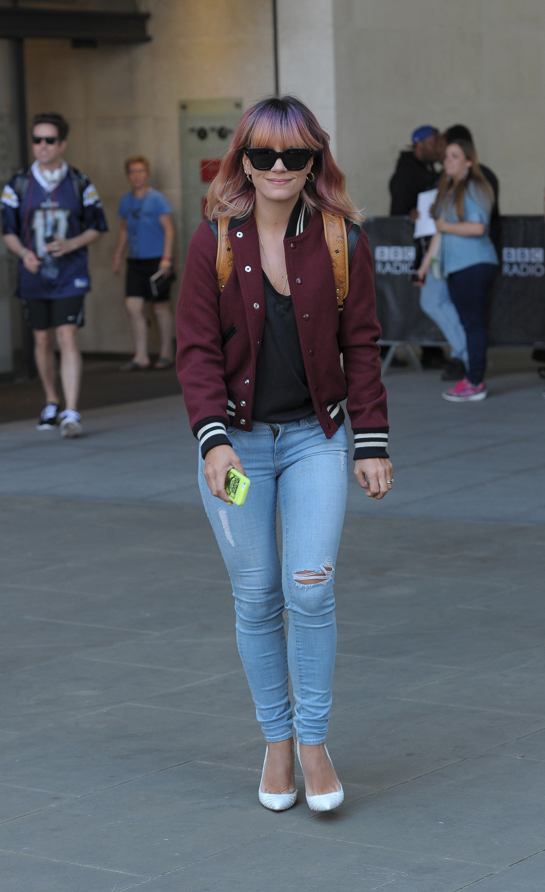 Lily Allen looked too cool for school in a maroon jacket, denim skinnies and a beige backpack slung over her shoulders.