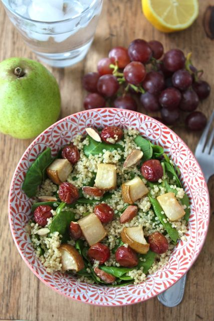Spinach quinoa salad with roasted grapes, pears, and almonds