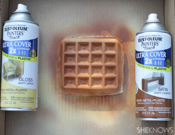 After waffle is dry and hardened, spray both sides with light yellow and brown paints.