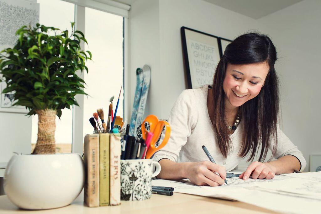 Johanna Basford at her desk