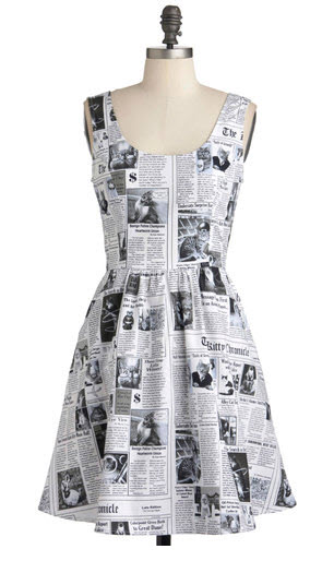 Cats in the newspaper dress