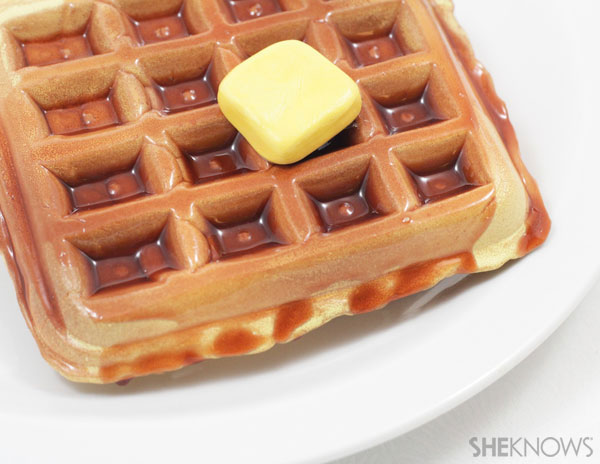 Glue a yellow butter square to the syrup side of the waffle