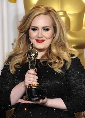 Adele holds her Oscar