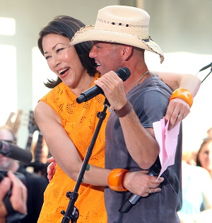 Ann Curry's happier times, with Kenny Chesney