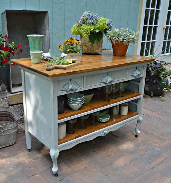 15 funky kitchen islands that will make you jump on the repurposing rh sheknows com diy kitchen island out of dresser make your own kitchen island out of a dresser