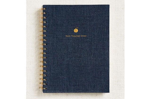 "Dark blue journal with gold accents that reads, ""Best Teacher Ever"""