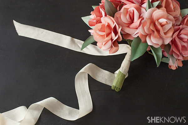 Wrap ribbon around the base of the bridal bouquet