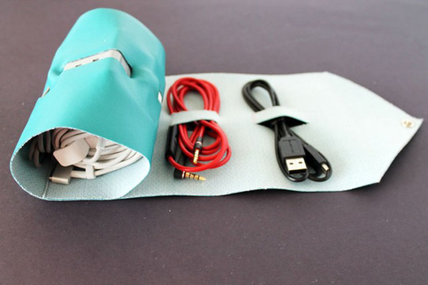 Keep cords organized while traveling with this DIY cord roll.