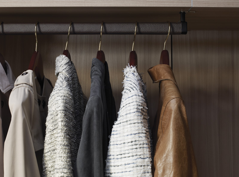 Clothes hanging on hangers from California Closets