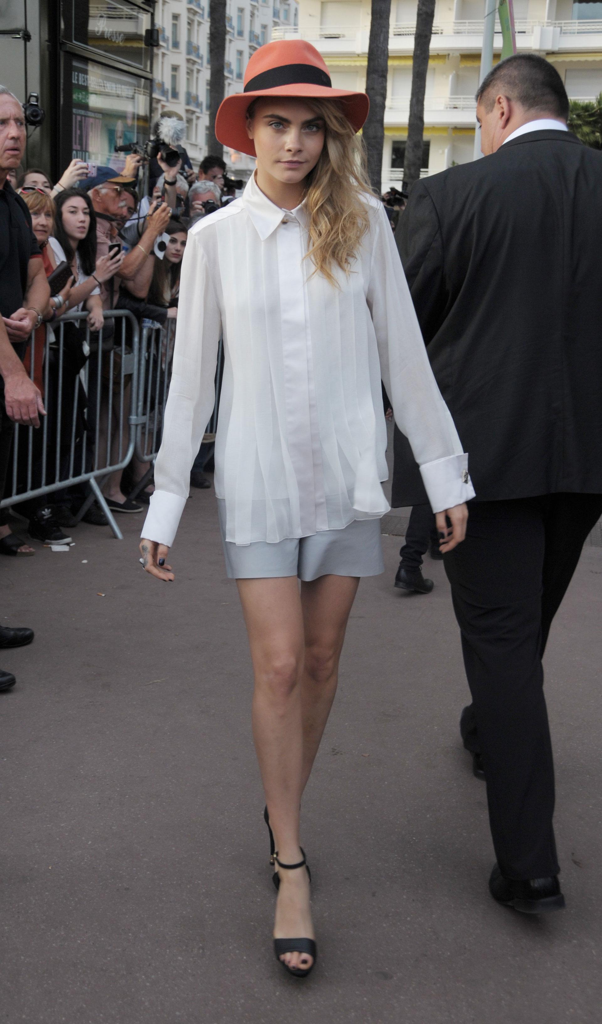 Cara D: A white silk button-down blouse