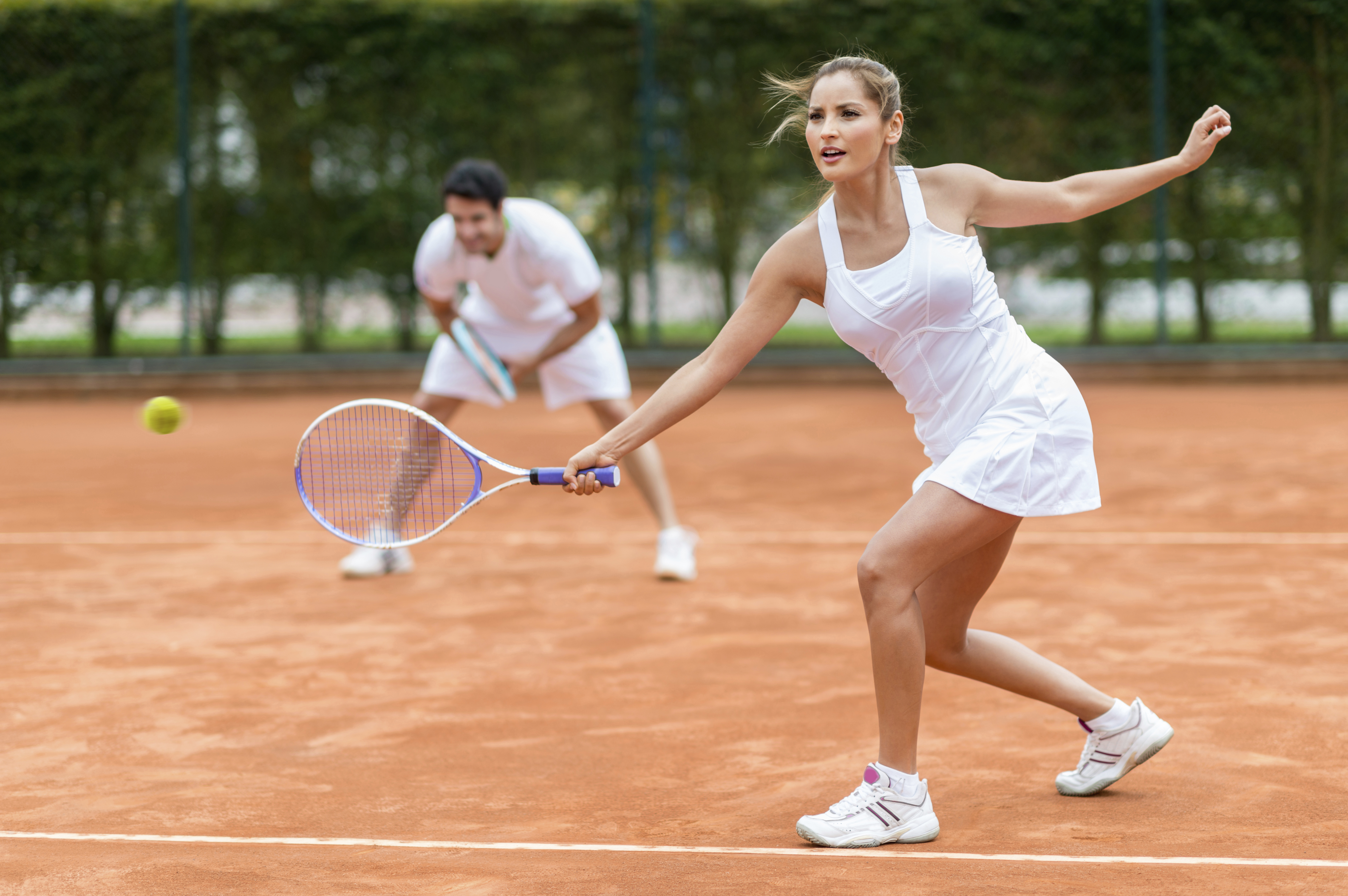 couple playing tennis on a date