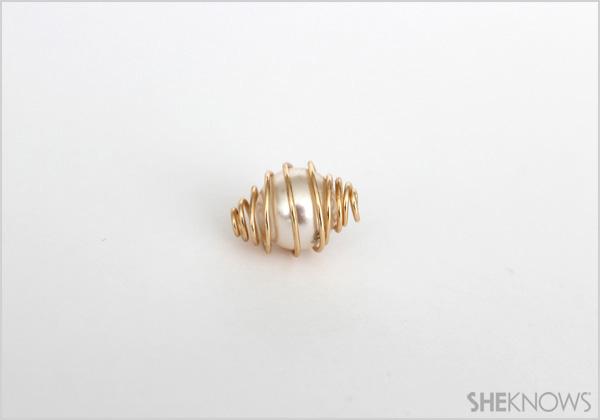 DIY Caged bird necklace Step 6: adjust cage around pearl