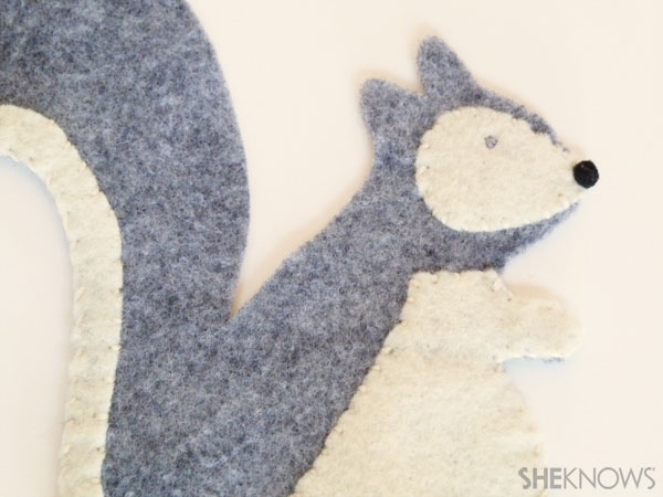 DIY Felt Squirrel: Step 4 sew on eyes and nose