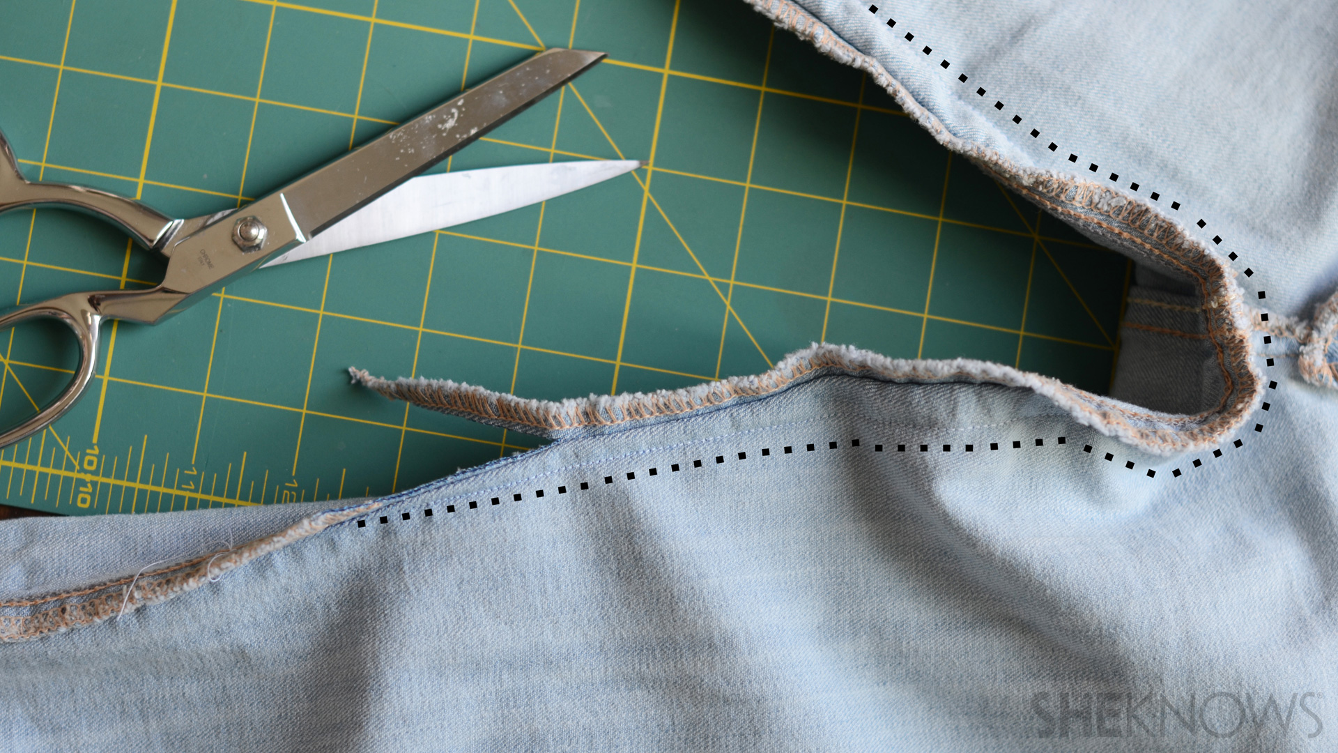 Cut the excess jeans along the new hem line