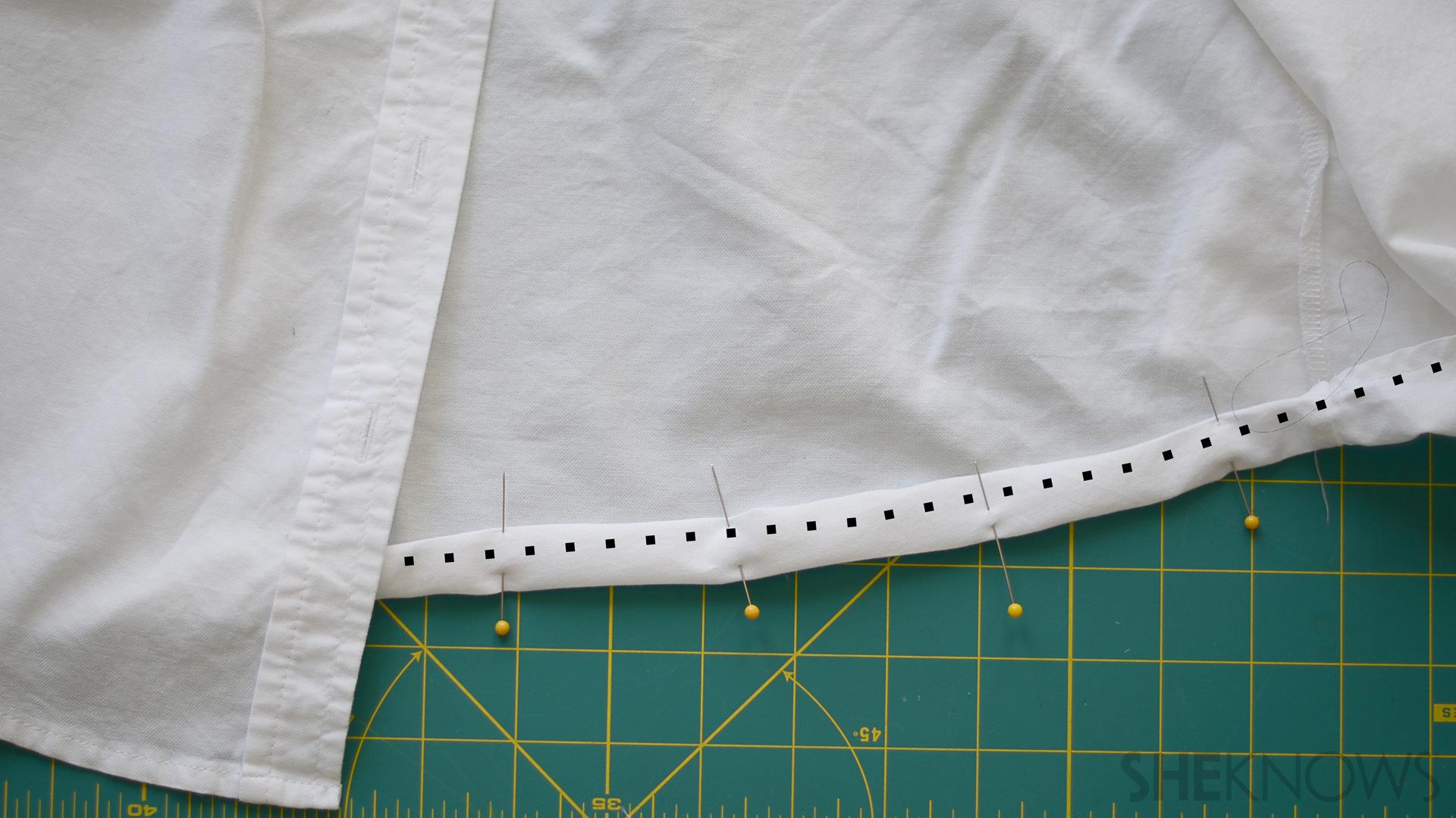 Hemmed edge of a shirt pinned down
