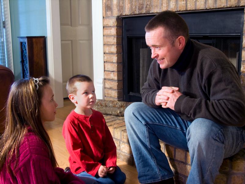 Dad talking to kids