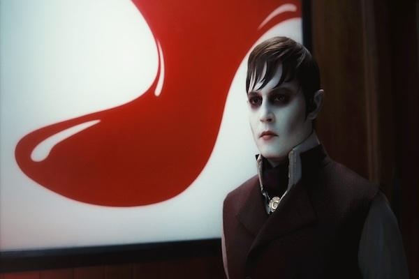 Dark Shadows Johnny Depp in front of red painting