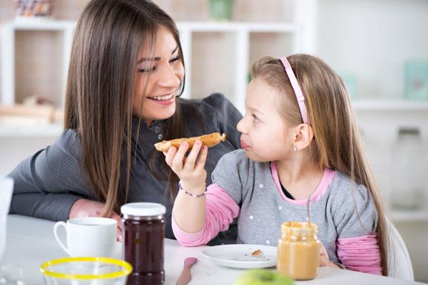 Daughter eating breakfast