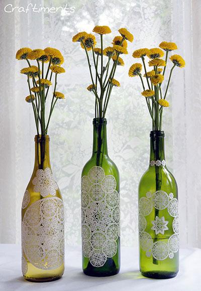 Doily decoupaged wine bottles