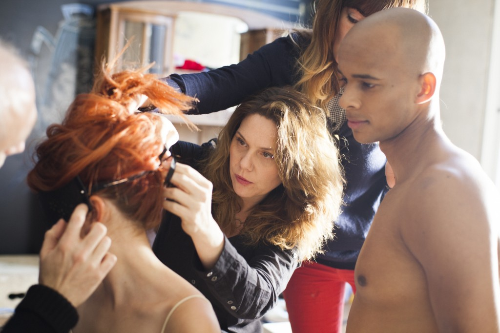 Erika Lust helps with hairdressing on the set of one of her films. Photo credit: Rocio Lunaire