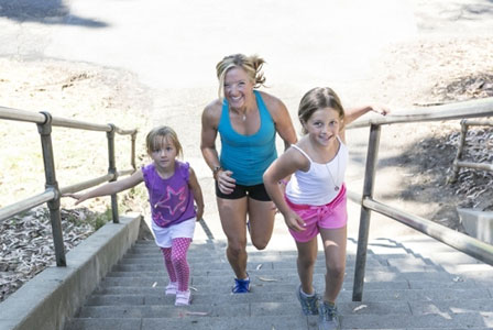 Erin running up stairs with her daughters