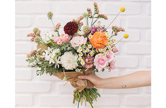 Woman holds a beautiful bouquet of flowers