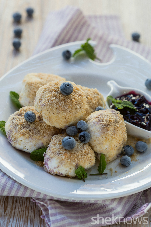 Frozen blueberry cheesecake balls - vertical