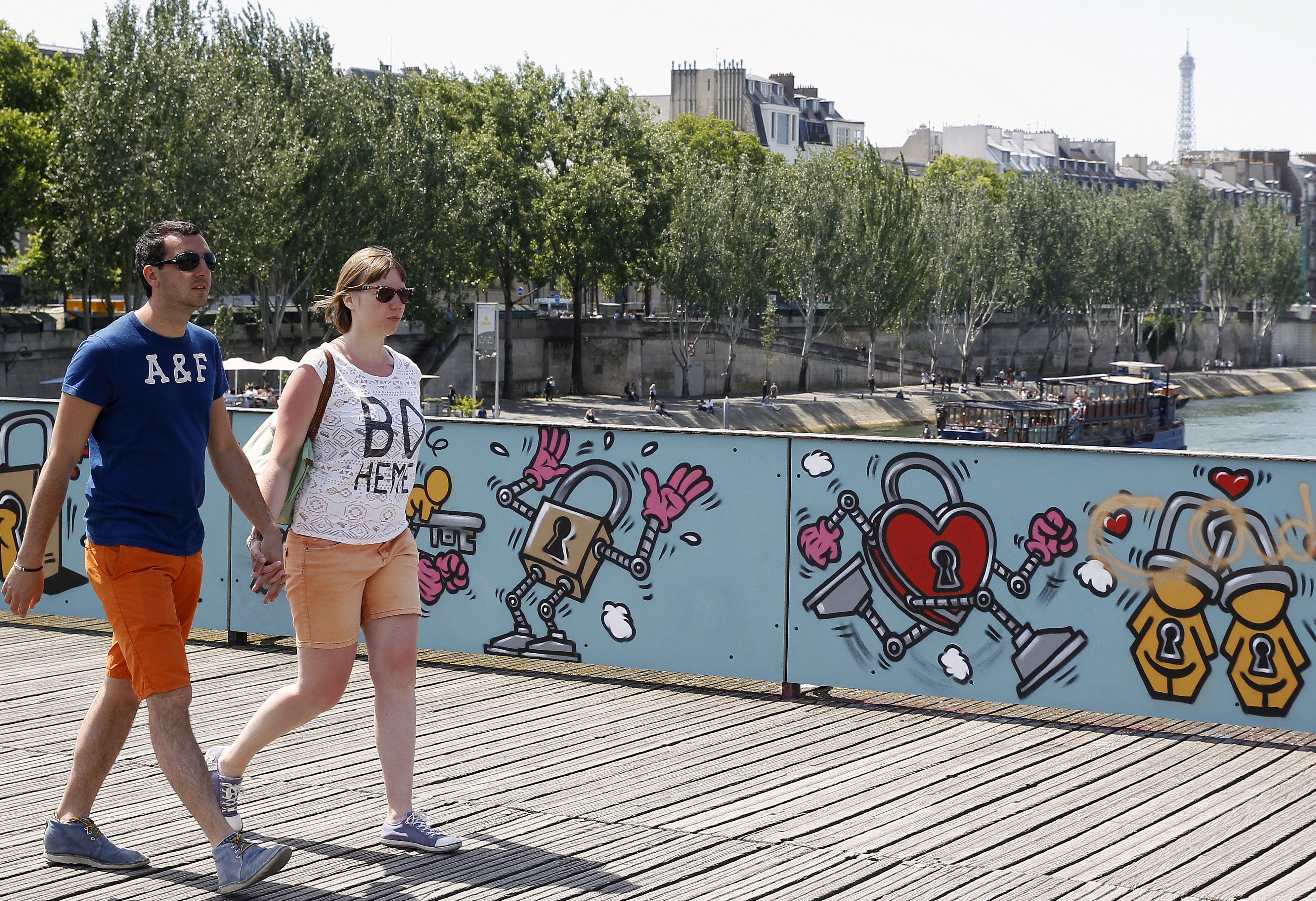 Paris 'Love Padlocks' Are Replaced By Temporary Panels Signed By Graffiti Artists Brusk, Pantonio, Jace and El Seed At Pont Des Arts