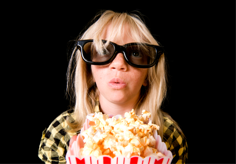 Girl wearing 3-D glasses