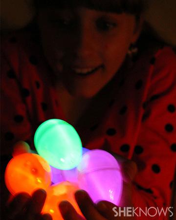 Girl holding glow in the dark eggs