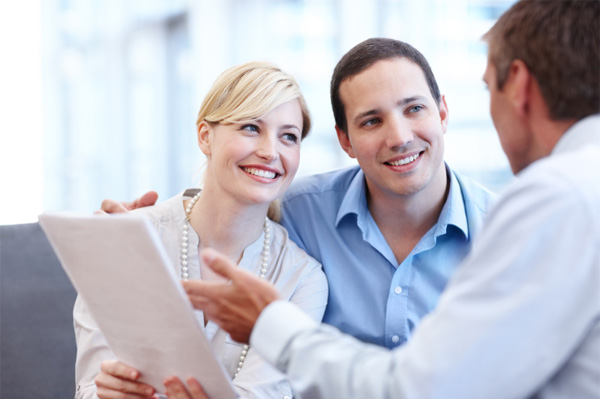 Happy couple meeting with insurance agent