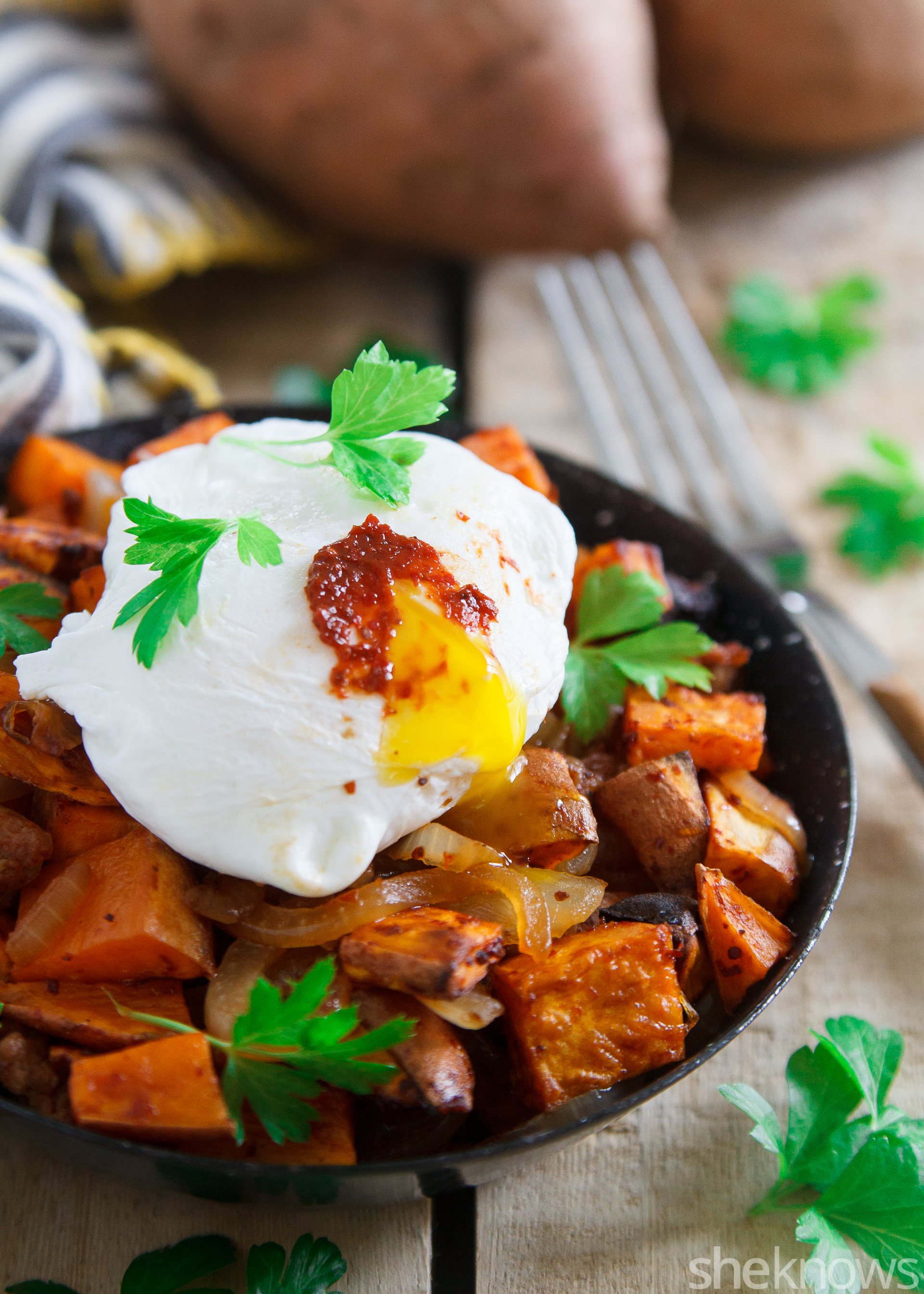 Harissa sweet potato hash with poached eggs